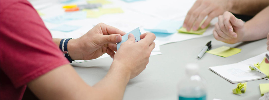 B2B marketing agency using sticky notes to brainstorm during a planning session with a client