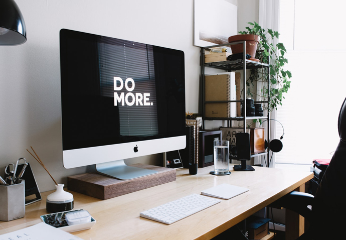 Mac with a screensaver telling B2B marketers to 'do more' to become better in 2020