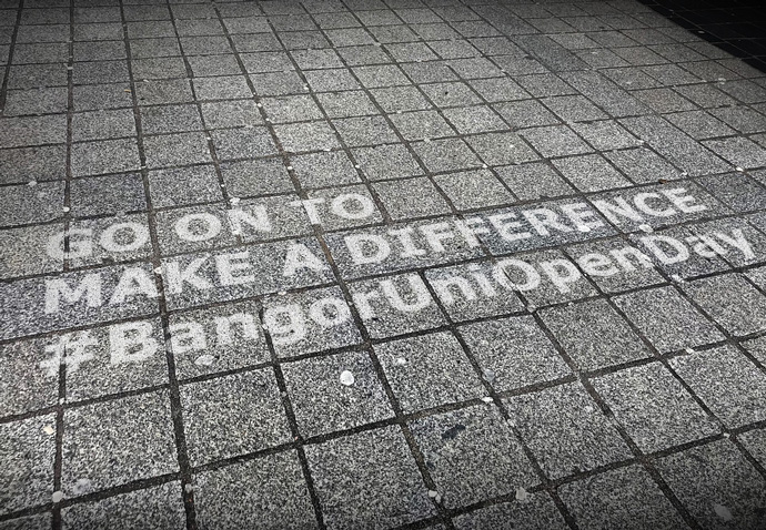 Clean graffiti on a pavement being used to promote Bangor University Open days as part of a guerrilla advertising campaign