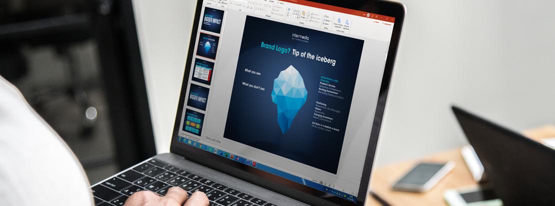 Branding Iceberg' model displayed on a laptop being used during a branding agency workshop