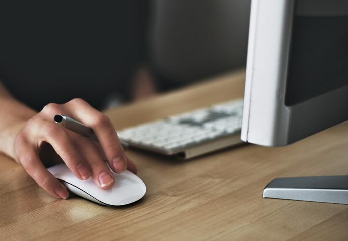 Member of a branding agency design team producing creative work on an iMac