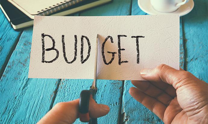 Man Cutting Budget