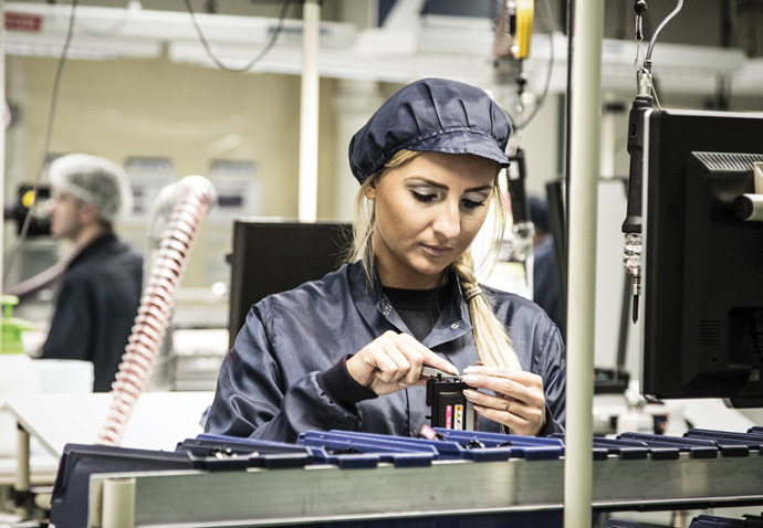 Female worker in a manufacturing facility photographed for Gap's brochure for the manufacturing sector