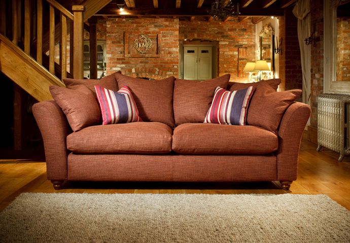Product photography showing a settee in a cottage from the Spirit range used in their ecommerce website design and brochure