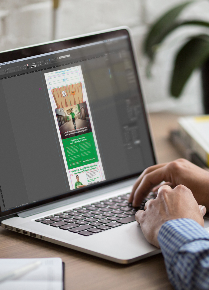 Designer in the marketing agency design studio creating artwork for a direct mail campaign