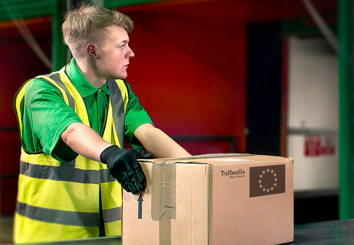 Retouched photograph of a Tuffnells warehouse worker created by intermedia for use on their new website