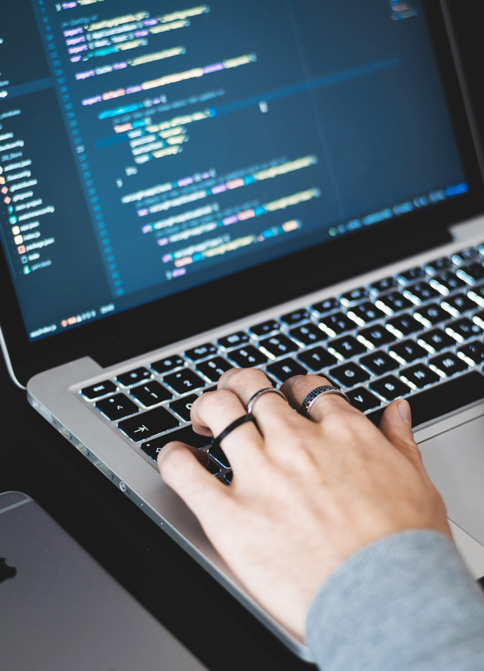 Marketing agency web developer coding on a laptop