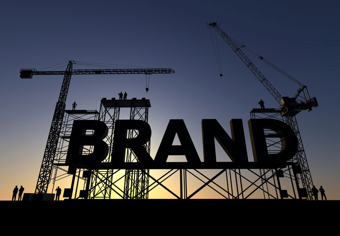 The word brand being constructed by cranes