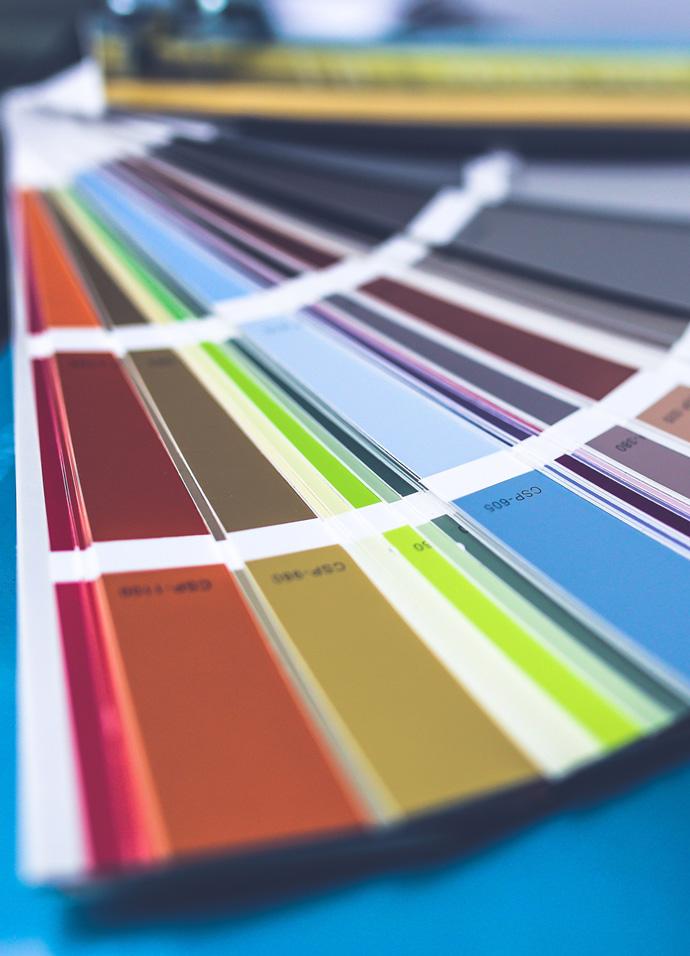 Colour palatte book on the desk of a branding agency designer