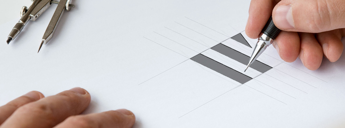 Branding agency designer sketching a new logo for a client