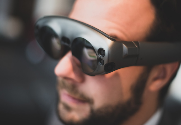 Business man in VR headset – representing technological innovation in business