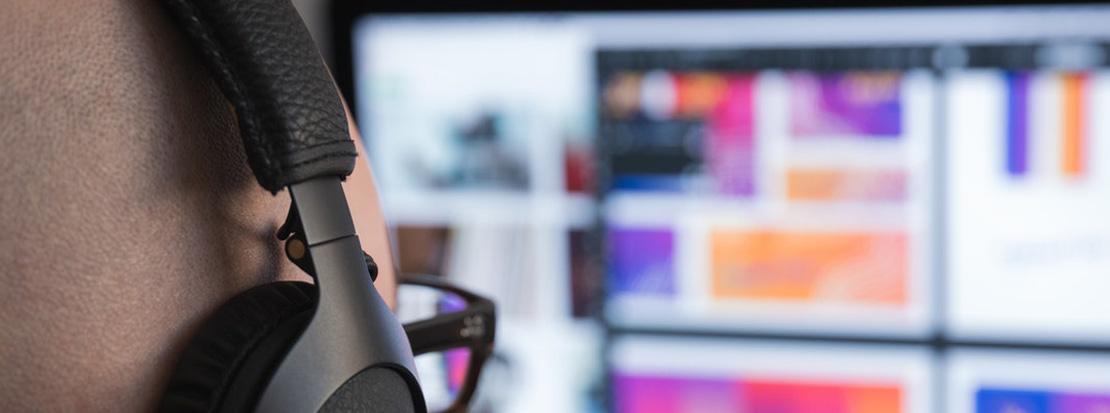 Marketing agency designer creating a website design on a desktop computer